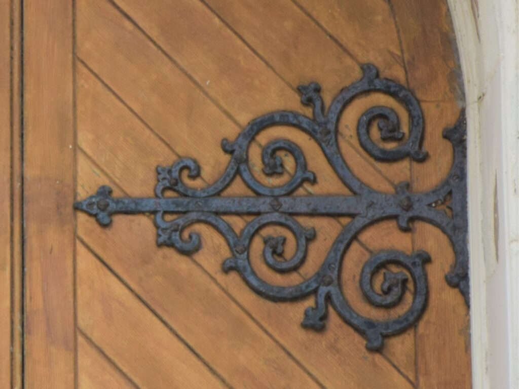 This ornate metal detailing is on a door of which building?