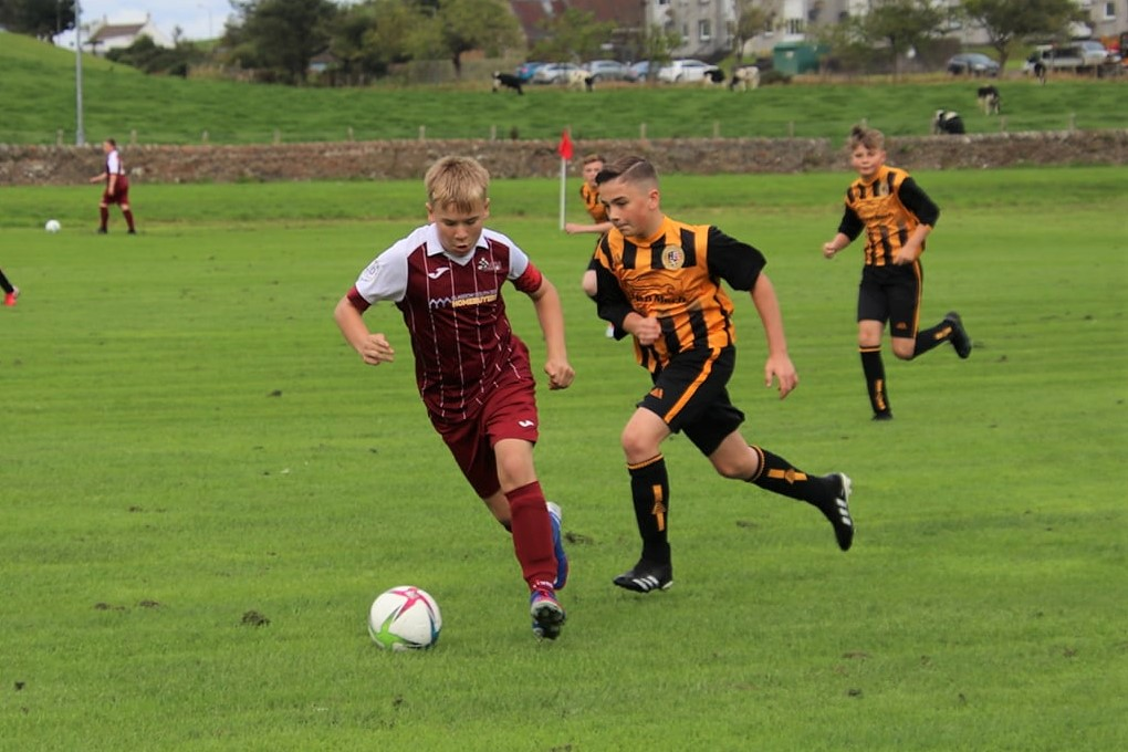 Rio Arkell chasing down the ball.