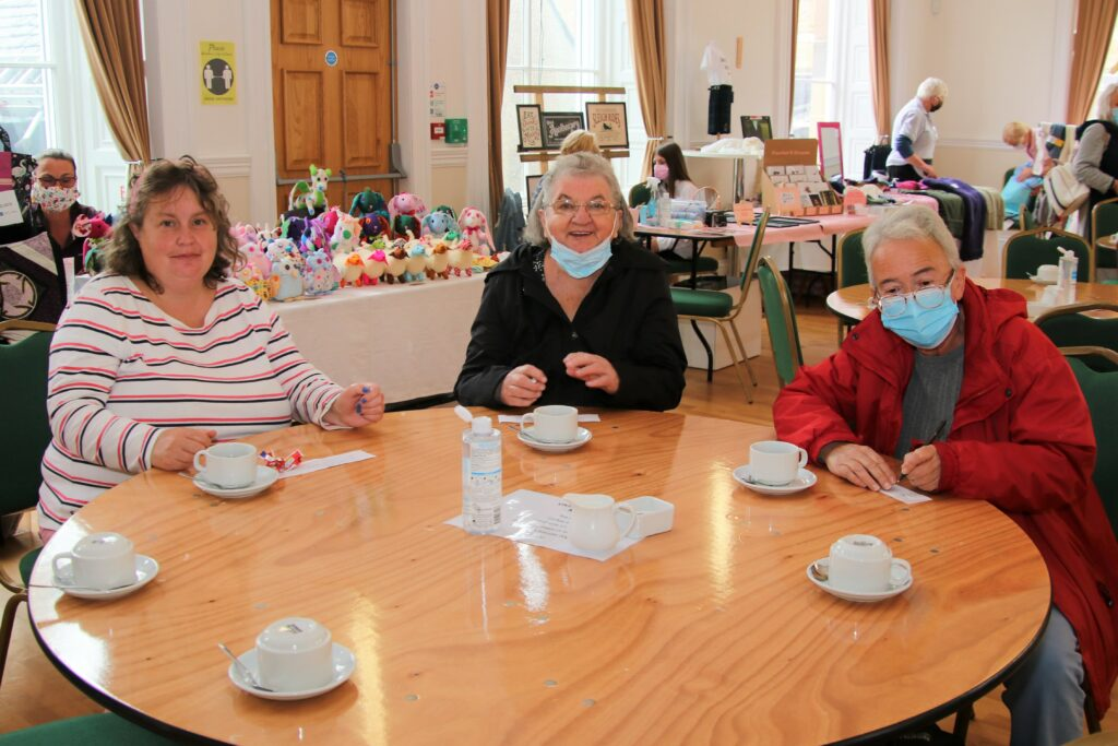 From left: Lorna Hume, Cathie Duncan and Mhairi Reid enjoying an overdue catch-up at the craft fair.