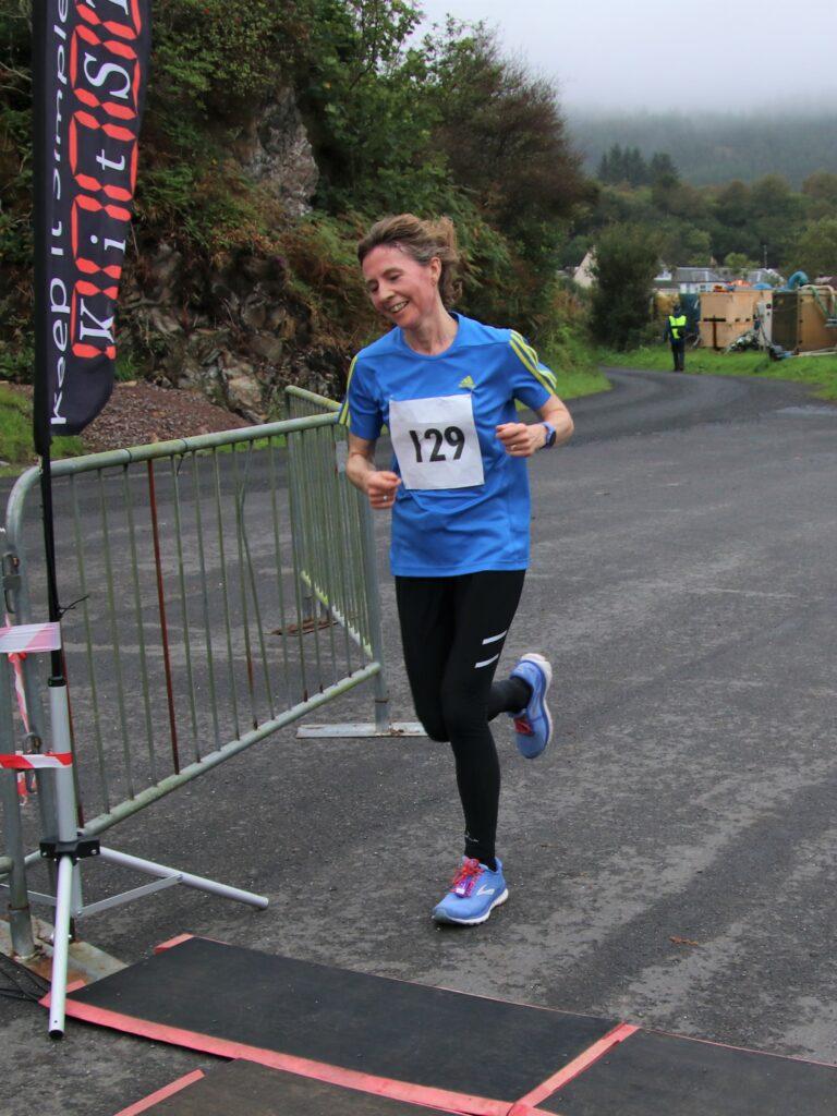 Ladies' 5K winner Lynne Gemmell was all smiles as she crossed the finish line.