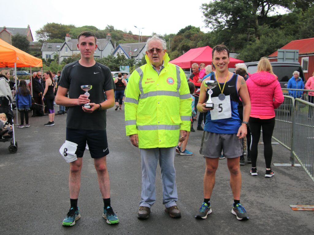 The weather might have been dull but nothing could dampen the spirits of the Great Carradale Canter's 10K race winner Jamie Ferguson, right, and runner up Neil Littleson, left.