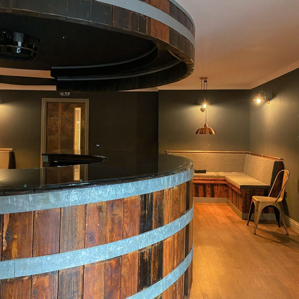 The actual bar is built from one of Springbank's former washbacks, large containers used during the fermentation stage of the whisky-making process.