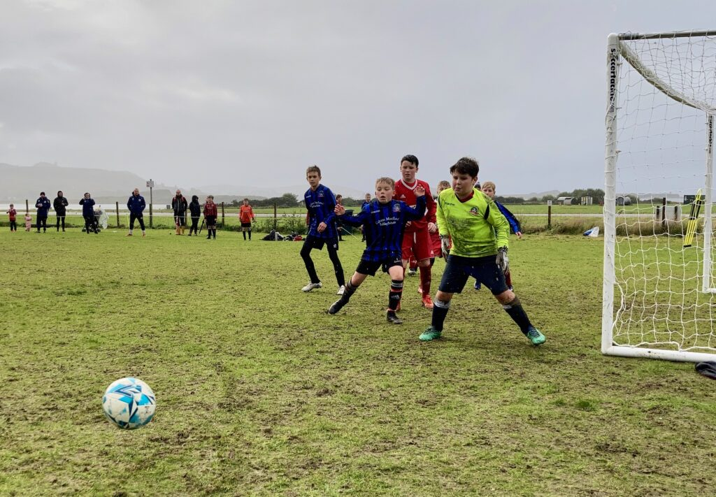 Players from the Oban Saints and Campbeltown 2010 teams contest a corner kick.
