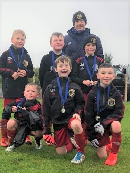These 2013s players sported their medals proudly.