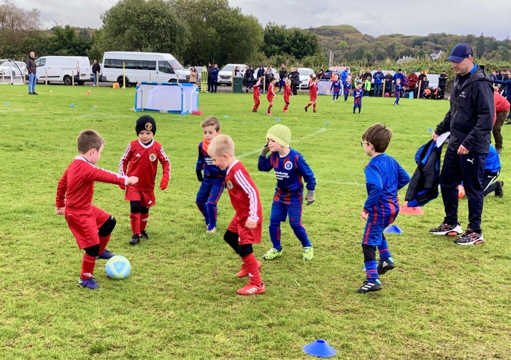 Youngsters from Campbeltown and Lochgilphead compete for the ball in the fun fours.