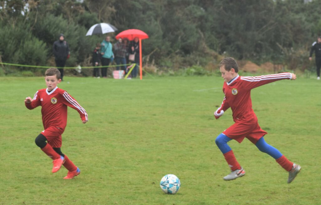 Drizzle failed to dampen the young Campbeltown players' spirit.