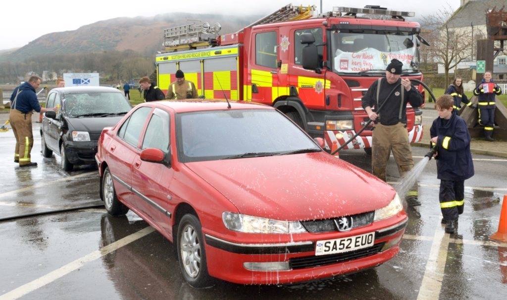 Young firefighters' hose down cars
