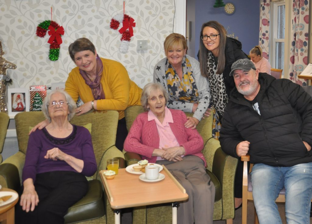 There was music, dancing and visits from family at Kintyre Care Home's Christmas celebration. Residents Annie Thompson, left, and Catherine Wareham, right, sitting in the green chairs, welcomed Helen Shaw, Catherine Murray, Kerri Ann Murray and Arthur Murray to the care home party.