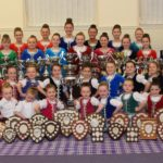 Most of the members of James McCorkindale School of Dancing among a sea of silverware from the 2019 season.