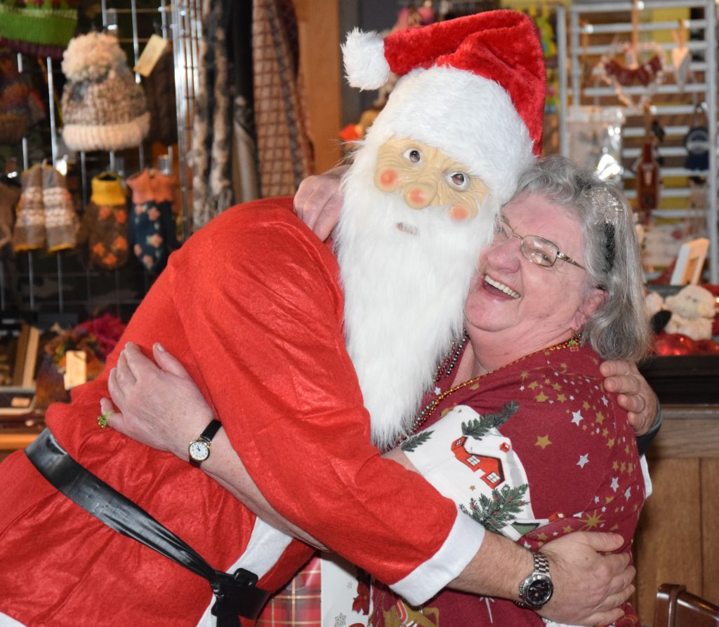 The Monday Social Club party organiser, Cathie Duncan, got an extra tight hug from Santa.