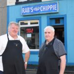 Robert Brown, left, and John McIlroy, right, standing in front of the iconic Campbeltown take-away.