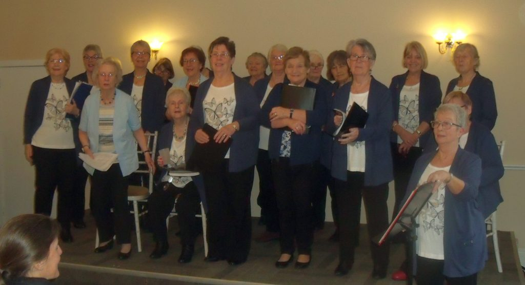 The members of the U3A choir donned their new uniform for the first of their festive performances.