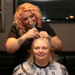 Joanna McMillan was still smiling as hair stylist Kim Mathieson began to cut her hair.