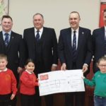 At the cheque presentation, back row, from left: Donald James Angus Lawson, Robert Wilson, Jim Parr and Archie Martin. Front: Harrison Ward, Eva McFadyen and Rowan Brodie.