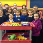 Members of Castlehill Primary School's pupil council with Kerry McGeachy, giving out fruit to fellow students.