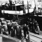 Whisky barrels, cargo and passengers await boarding onto a sister ship of the SS Davaar – making this ship either the Kinloch or the Kintyre - at Campbeltown Harbour.