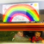 Brothers Kian Green, two, and Koen, one, smile after displaying their drawing as part of Kintyre Rainbow Trail.