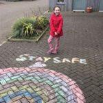 Mia McConnachie with her cheerful rainbow.