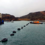 Storms delayed the installation of the submarine cable.