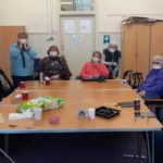 Members of the MS Social Group wearing their hand-made protective face masks.
