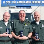 Robert Black, centre, with colleagues and friends Scott Ramsay, left, and James Stevenson, right, when they received their long service medals.