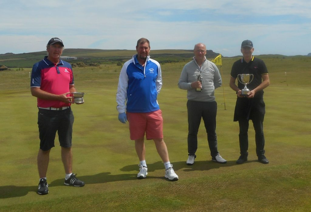 From left: Senior champion Donald McNeill, acting club captain Raymond Harvey, handicap champion David MacBrayne, and club champion George MacMillan.