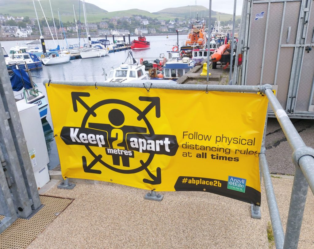 A sign in Campbeltown advising people to adhere to physical distancing rules at all times.