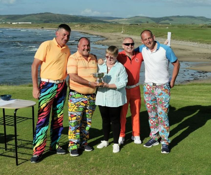 Sheena Robertson, centre, with the winning team, from left: Stuart Campbell, David Rankin, Stephen Kelly and Darren Kelly.