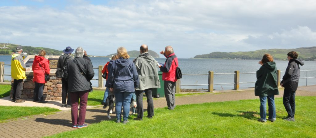 Walkers on a previous tour standing on Quarry Green and looking towards Fort Argyll.