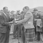 Donald Armour, Kilkeddan, receives the Tom Douglas Cup from the Duke of Argyll for the 1959 champion Ayrshire.
