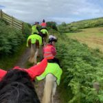 Mairi Ralston and her daughters, 11-year-old Erin and eight-year-old Louise, during a recent outing on the horses.