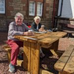 David and Jane Mayo enjoying a cuppa at the cinema's outdoor seating area.
