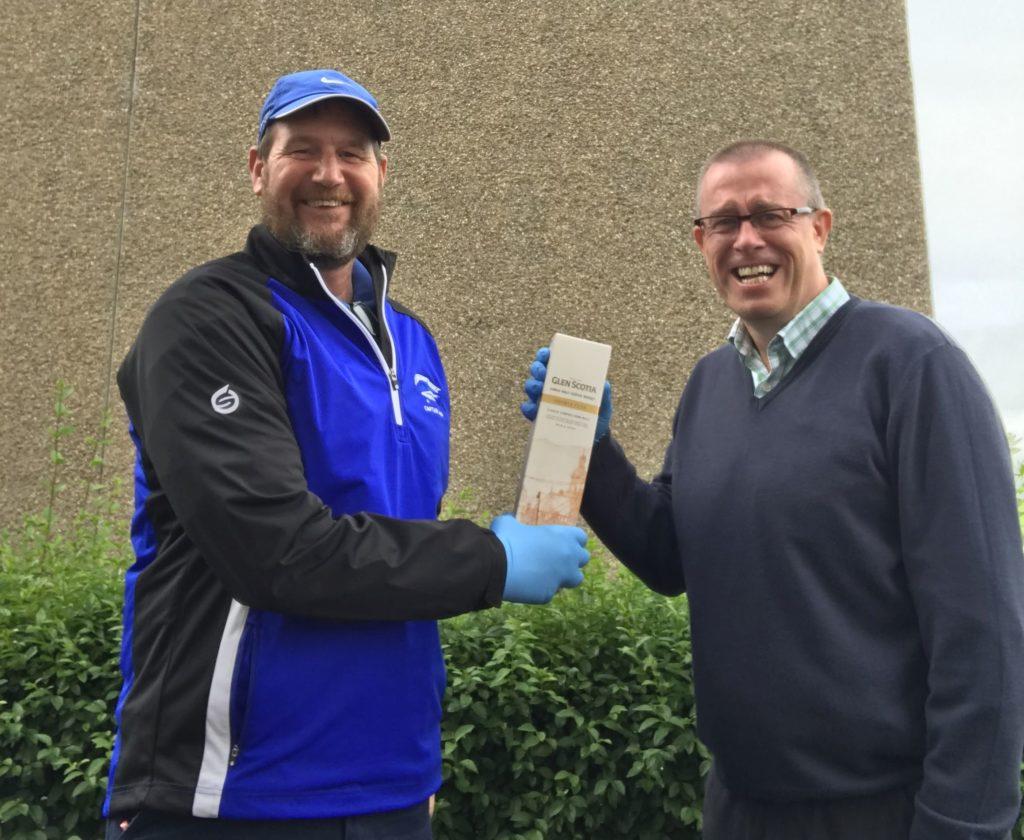Acting club captain Raymond Harvey, left, presenting winner David Hanley with his prize.