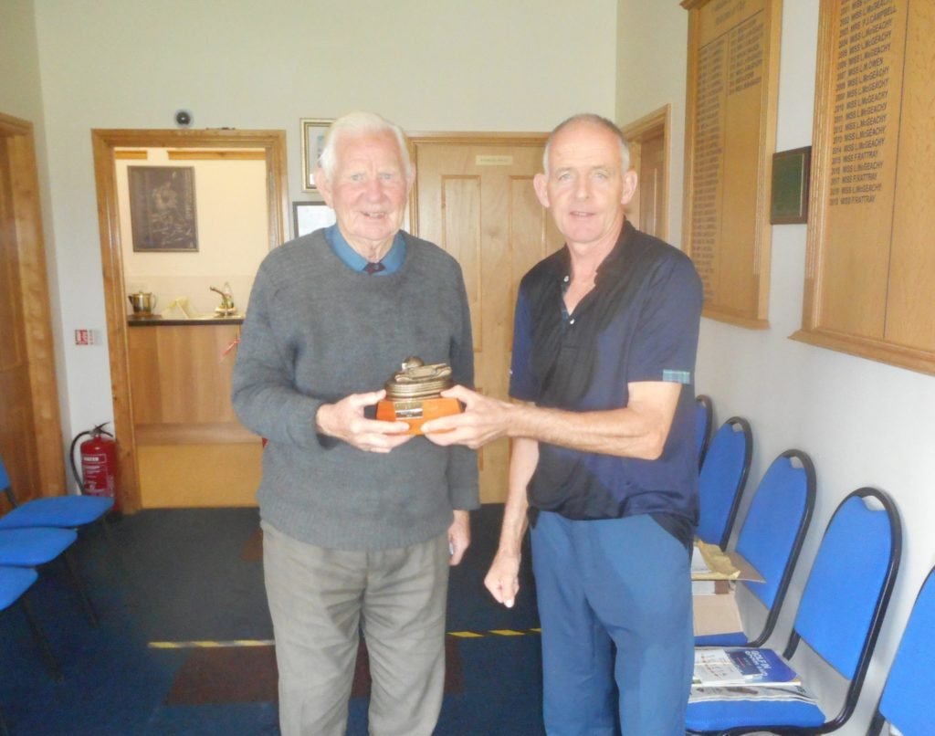 Last year's winner, Malcolm Ronald, right, presenting this year's victor, Sandy Watson, with the Heidbangers trophy.