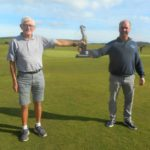 Last year's winner Bill Brannigan, left, presents the Jimmy Graham Trophy to Donald Brown, right, the 2020 champion.