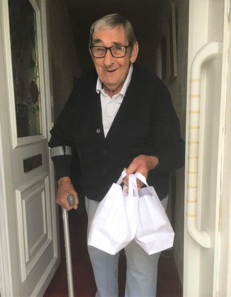 Bill Stewart receiving his afternoon tea goodie bag.