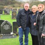Andrew, Sheena and Cassie Brown standing to the right of Donald's grave.
