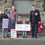 At the cheque presentation: Chelsea and John Willis, holding baby George, left, fundraising hero Emelie, centre, and Richard Cameron, Campbeltown's area convenor for Poppyscotland, right.