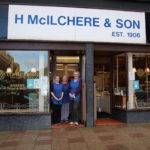 Employees Lisa McEachran and Joanne Tiffin with shop manager Christine Rennie outside McIlcheres on its final day in business.
