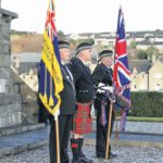 In 2010: For the first time ever, Royal British Legion Scotland colours were paraded at the Campbeltown War Memorial on Remembrance Sunday. Twins Tommy and Billy Morran carried the Legion standard and Union Flag and piper John McGeachy played Flowers of the Forest during the ceremony.