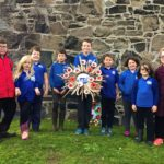 Children from Gigha Primary School with their Remembrance wreath.