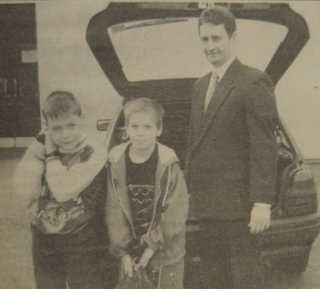 In 1995: Christopher and Mark help load the Blue Peter appeal bags into Mr Mackenzie's car.
