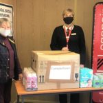 Mary Anne Stewart of Kintyre Food Bank, left, receives a donation from Jane McCallum of Loganair at Campbeltown Airport.