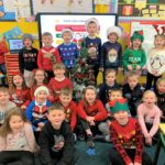 P2 pupils at Dalintober Primary School wearing colourful festive jumpers.
