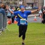 Race director Gail Williams was in good spirits as she neared the finish line.