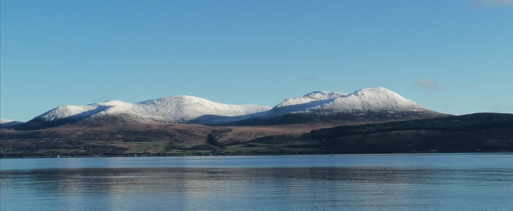 This photograph by Debra Clarke, taken from Shore Road in Carradale, shows a dusting of snow on the hills of Arran, across the Kilbrannan Sound.