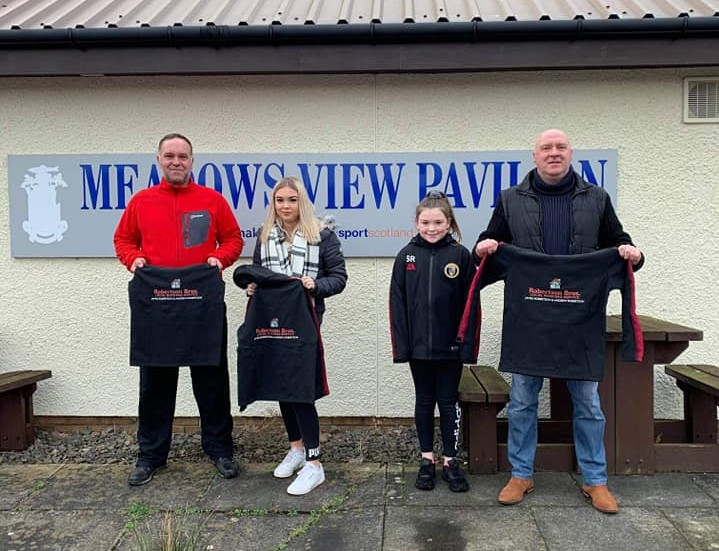 Andy and James Robertson of Robertson Bros sponsored kit for 28 youngsters in the girls' team.