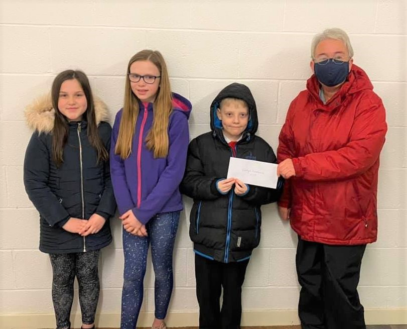Representatives from P6 and P7 presented a cheque for £50 to Mhairi Reid of Kintyre Food Bank.