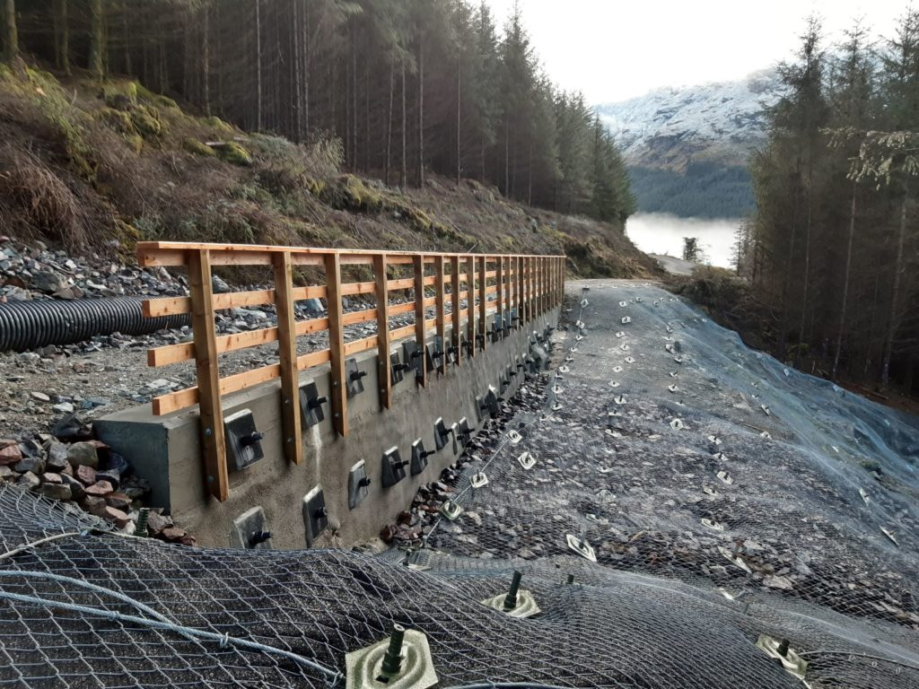 The completed reinforcement works where the road was partly washed away.