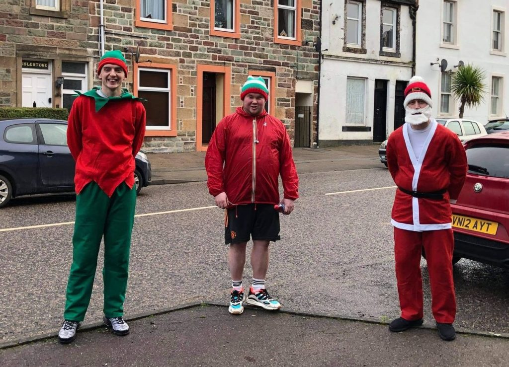 David Brown, right, was joined by Connor Molloy, left, and Andrew Robertson, centre, for his Christmas Day run.